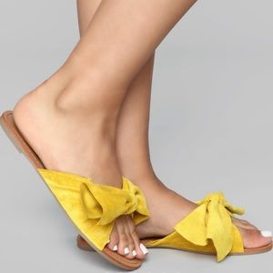 Yellow bow tie sandals